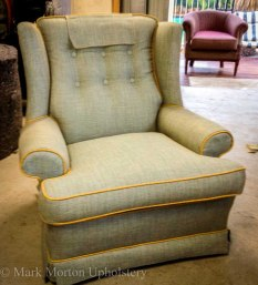 Green armchair upholstering finished
