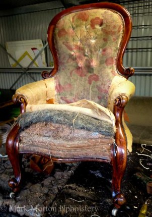 Gold armchair before upholstering photo